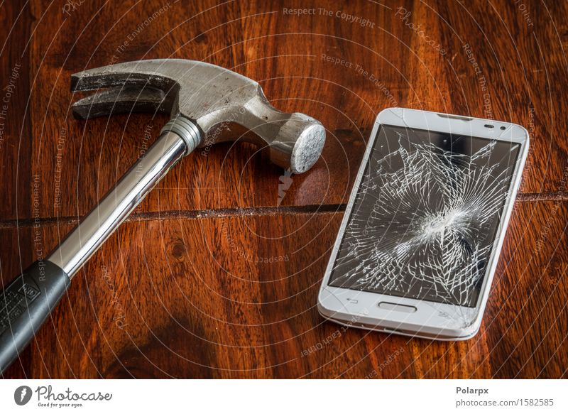 Smashed phone screen on a table Telephone Cellphone PDA Screen Technology Wood Modern Smart Black White Destruction mobile broken communication accident