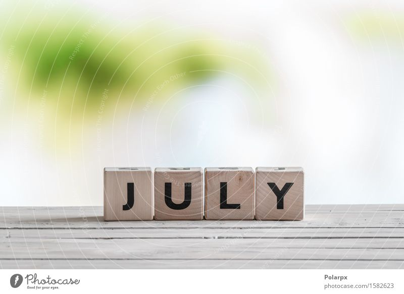 July sign on a wooden table Summer Wood Playing Group Design Infancy Uniqueness Reading Symbols and metaphors Discover Calendar Word Text Build