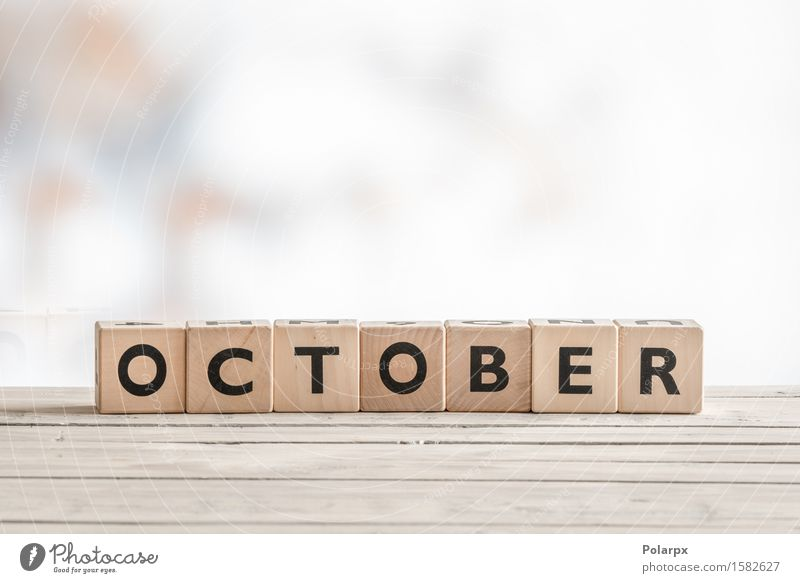 October sign made of wooden cubes Colour White Autumn Wood Playing Art Design Uniqueness Signage Reading Symbols and metaphors Calendar Toys Word Text Comic