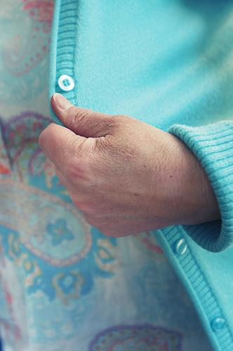 woman's hand on turquoise cardigan - off to the opera ball! Hand Cardigan Jacket Buttons Turquoise Light blue Soft knitwear home fashion Clothing Comfortable