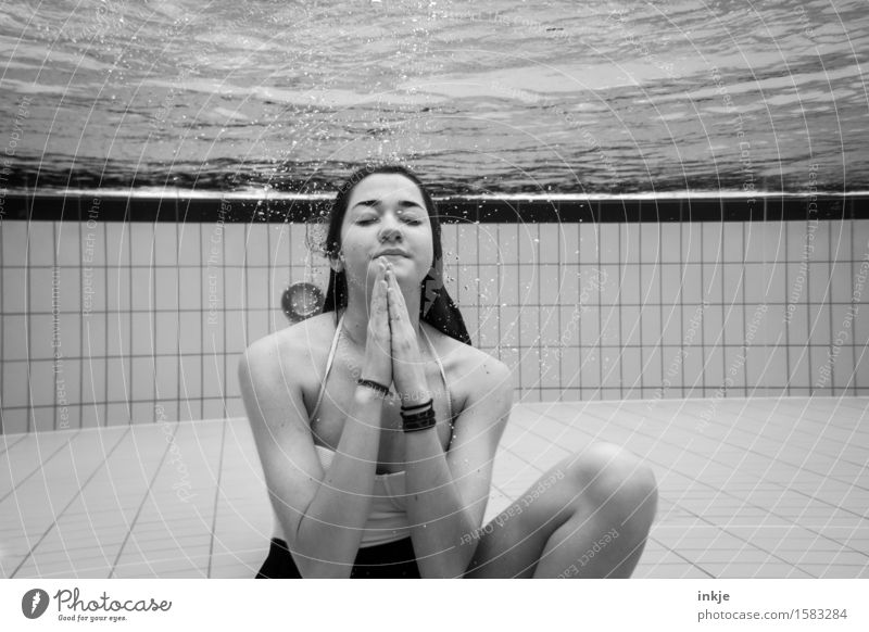 Woman under water with hands together Body Wellness Harmonious Well-being Senses Relaxation Calm Meditation Swimming pool Swimming & Bathing Leisure and hobbies