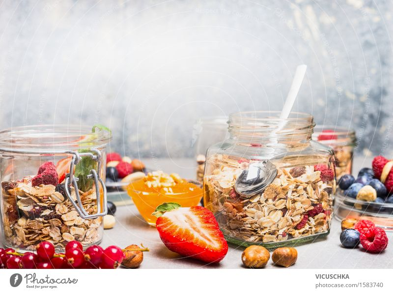 Muesli in glass with berries and nuts Food Fruit Grain Dessert Nutrition Breakfast Organic produce Vegetarian diet Diet Glass Spoon Lifestyle Style