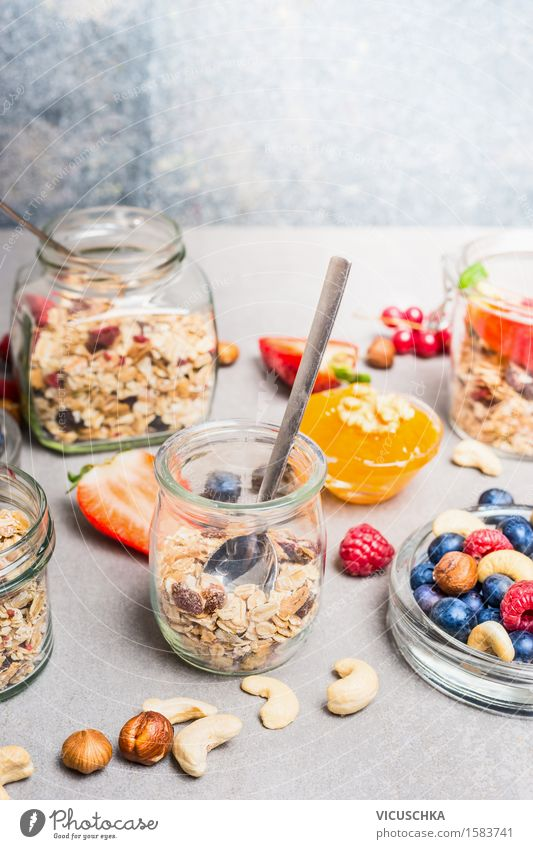 Breakfast in glass with fresh berries, nuts and muesli Food Yoghurt Fruit Grain Dessert Nutrition Buffet Brunch Organic produce Vegetarian diet Diet Glass Spoon