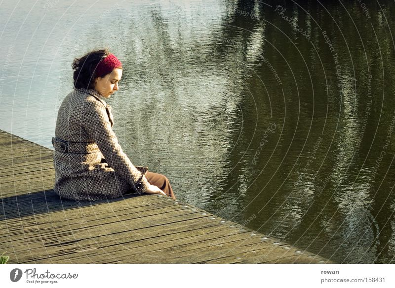 Woman Human being Youth (Young adults) Green Calm Loneliness Relaxation Feminine Sadness Lake Think Contentment Brown Adults Sit Grief