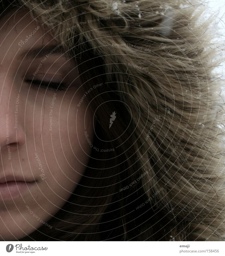 just take a breath. Face Half Young woman Skin Snowfall Winter Cold Brown Closed eyes Woman Clothing Pelt Wrap up warm Inuit