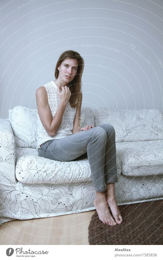 Learn more about it Elegant Sofa Room Young woman Youth (Young adults) Legs 18 - 30 years Adults Jeans Top Barefoot Brunette Long-haired Looking Sit Esthetic