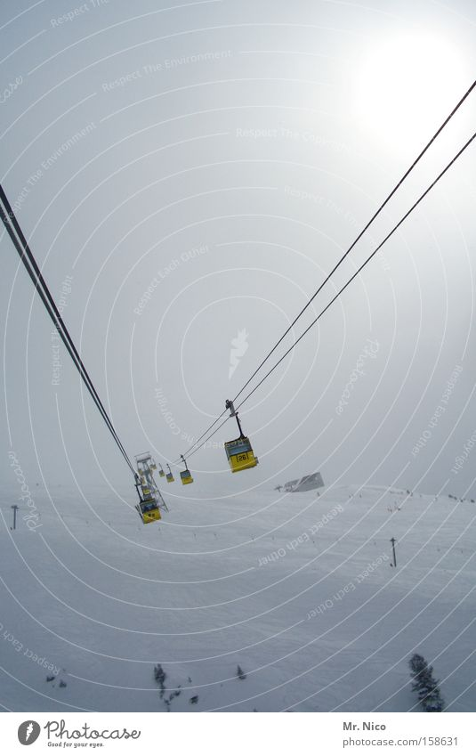 Winter Yellow Snow Mountain Fog Aviation Hover Passenger traffic Means of transport Ski resort Gondola Cable car Wire cable Vanishing point Building line