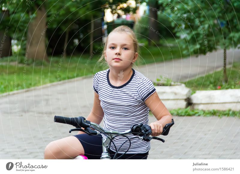 Cute girl driving bicycle in summer Summer Child Schoolchild Girl Woman Adults Infancy 8 - 13 years Autumn Blonde Driving White roller Ice-skates kid six 7