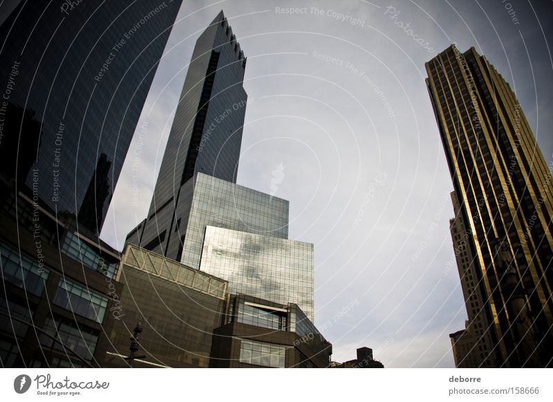 Looking up at the New York City skyline. Sky Clouds Town Capital city High-rise Famousness Success Fantastic Rich Gold Gray Decadence USA Colour photo