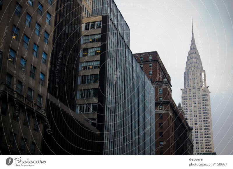 Looking up at buildings in New York City with the Chrysler Building in the background. Sky Town Capital city Downtown Populated Overpopulated