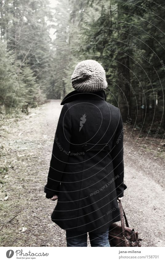 Grey cap in the forest Forest Lanes & trails Footpath Dark Bright Going Back Bag Coat Cap Loneliness Winter Woman Transience