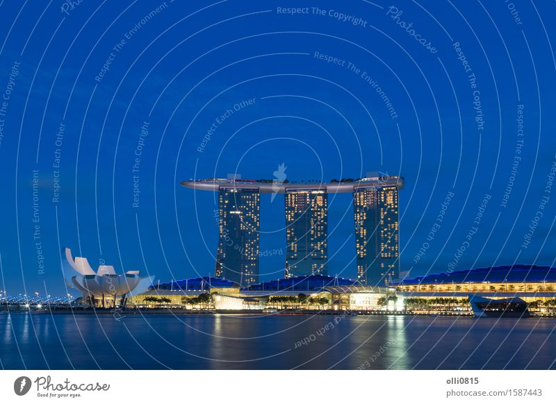 Marina Bay Sands in Singapore by night Luxury Vacation & Travel Tourism Town High-rise Architecture Modern district Hotel cityscape tower central light Resort