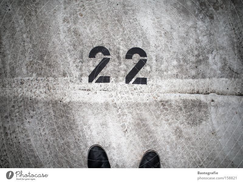 22 Digits and numbers Footwear Street Parking lot Motor vehicle Tracks Footprint Concrete Tar Transport Traffic infrastructure schnapps number Dirty