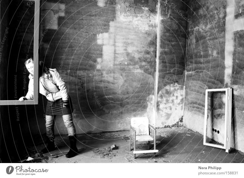 Woman Old Black & white photo Loneliness Wall (building) Window Factory Chair Broken Image Derelict Painting and drawing (object) Whimsical Frame Human being