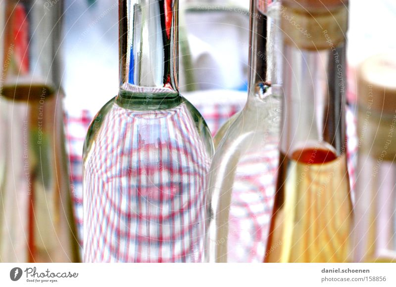 A bargain? Bottle Glass Spirits Alcoholic drinks Transparent Considerable more self-burned Glassbottle Neck of a bottle Detail Partially visible