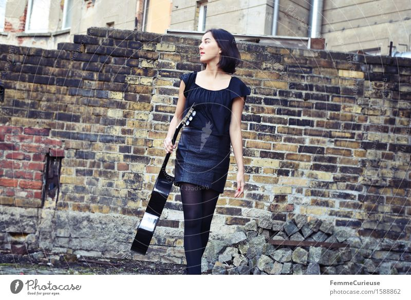Human being Woman Youth (Young adults) City Beautiful Young woman Calm 18 - 30 years Black Adults Style Lifestyle Wall (barrier) Leisure and hobbies Elegant