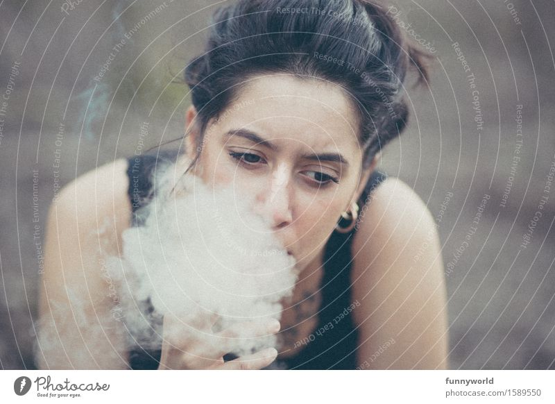 her Smoke Feminine Young woman Youth (Young adults) 18 - 30 years Adults Smoking Emotions Sadness Concern Pain Disappointment Aggravation Embitterment Cigarette