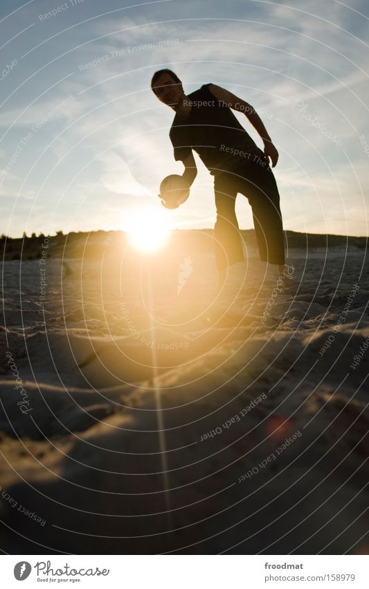 beach volleyball Silhouette Sand Beach Sun Back-light Youth (Young adults) Cool (slang) Warmth Athletic Evening Sunset Volleyball (sport) Sky Man Barefoot Ball