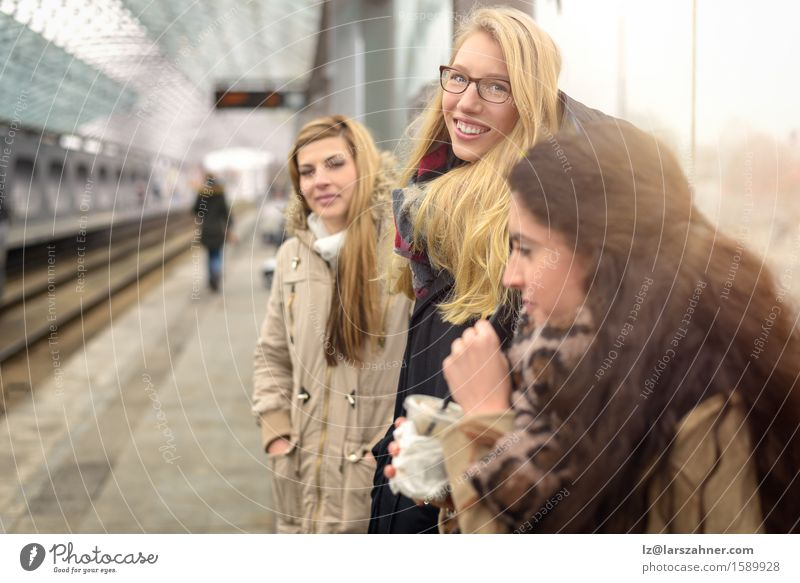 Atttractive young women waiting for train Happy Face Winter Woman Adults Friendship 3 Human being 18 - 30 years Youth (Young adults) Public transit Brunette