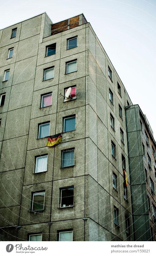 GERMAN LEITKULTUR Architecture Prefab construction Window Line Crazy Dark Gray Dismissive Flag Germany German Flag Federal eagle Pride Patriotism Berlin Dirty