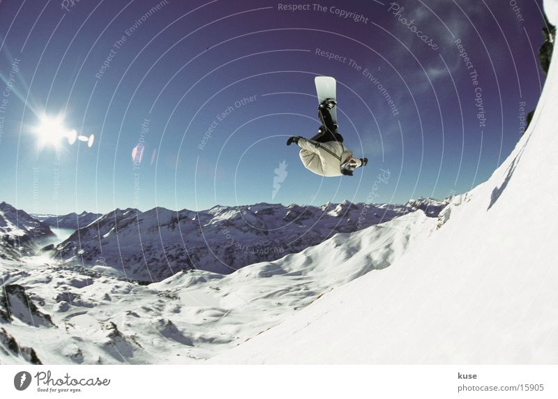 Sun Winter Mountain Snow Sports Idyll Large Beautiful weather Snowcapped peak Risk Brave Rotate Snowscape Blue sky Snowboard
