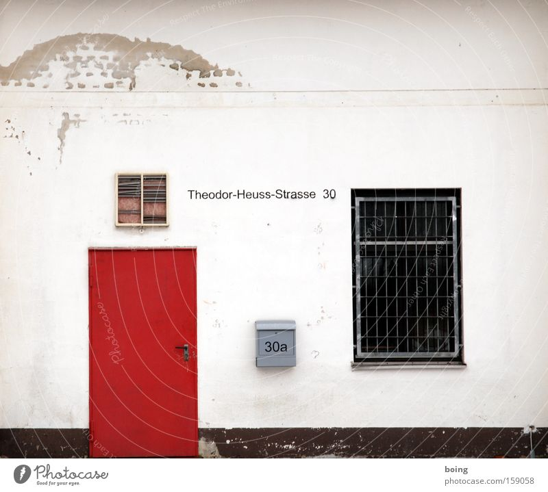 I see a red door Mailbox Facade Plaster Derelict President of the Republic Politician Grating Window 30 Burglar-proof Street sign Safety Theodor Heuss
