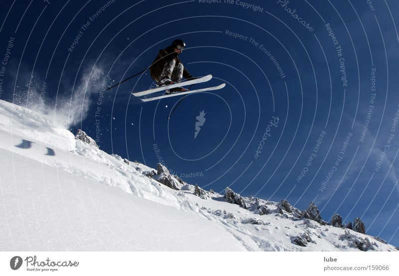 THE HIGH-FLYER Skiing Winter Deep snow Powder snow Long jump Skier Winter sports Winter's day Snowscape Flying Sports Playing Extreme sports freerider