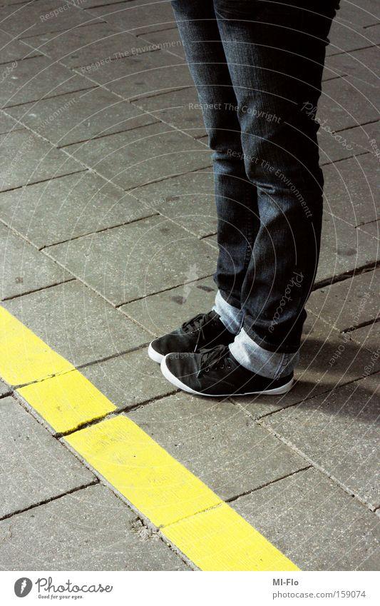 smoking enclosure Footwear Barrier Stone Legs Feet Train station Exterior shot