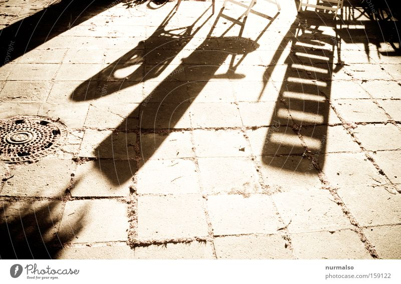 Tomorrow, as he becomes. . . Morning Shadow Chair Deckchair Floor covering Ground Stone Pattern Graphic Summer Garden Courtyard Warmth Sunrise Sunbeam Joy
