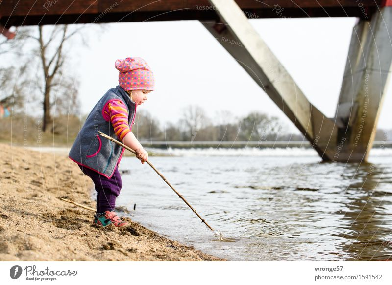 Playing at the river Child Toddler Girl Infancy 1 Human being 1 - 3 years River bank Beach Elbe Waterfall Wet Brown Gray Joy Effortless Bridge Sandy beach
