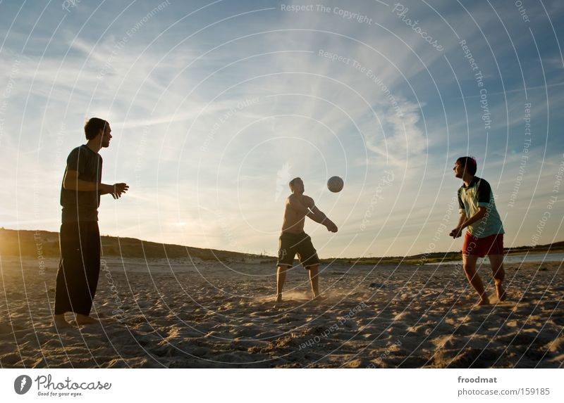 defence Silhouette Sand Ball Sun Back-light Youth (Young adults) Cool (slang) Warmth Athletic Playing Sunset Volleyball (sport) Jump Man Barefoot Tension Sports
