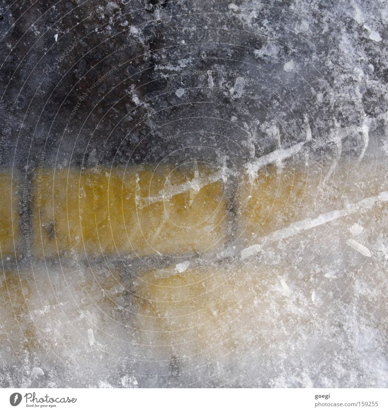 Ice (park) field Winter Frost Traffic infrastructure Signs and labeling Line Freeze Firm Cold Wet Yellow Black White Parking lot Tracks Skid marks Colour photo