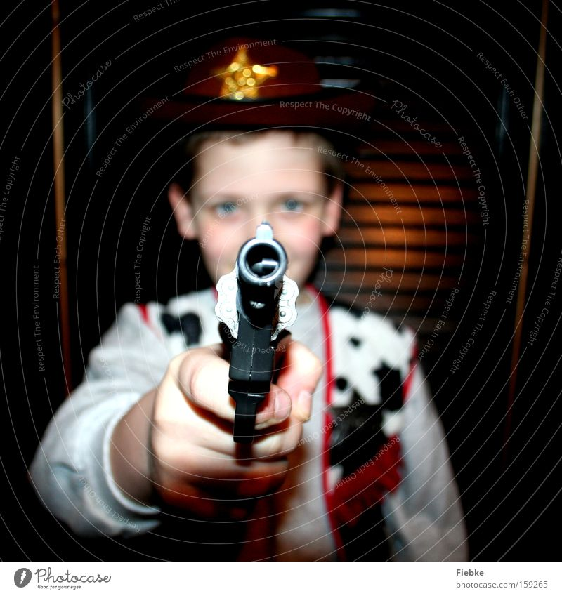 shooter Cowboy Duel Wild West Carnival Carnival costume Threat Boy (child) Child Tyranny Problem Playing Children's room problem child Joy Electricity Handgun