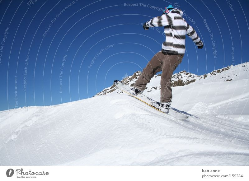 On the jump Snowboard Winter Jump Action Blue Sky Flying Sports Playing Winter sports Striped sweater Departure Snowboarding Snowboarder 1 Exterior shot