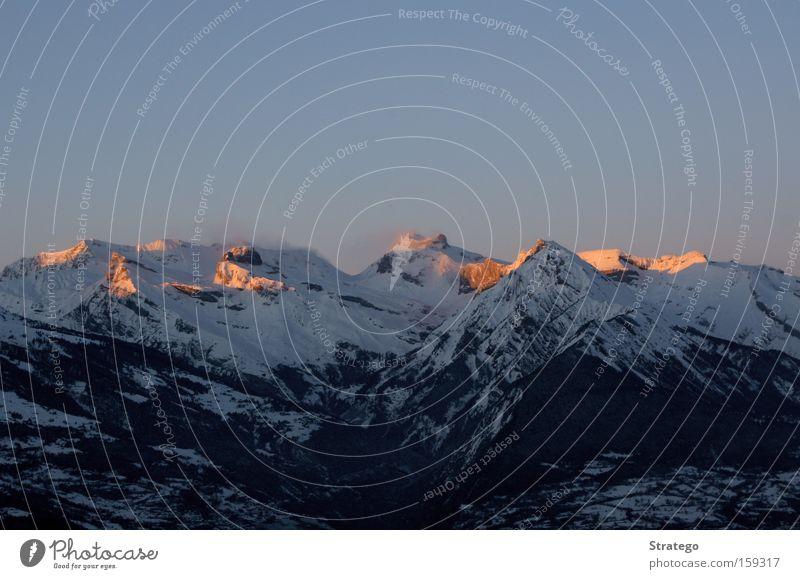 Red Winter Far-off places Snow Mountain Moody Level Vantage point Switzerland Alps Peak Swiss Alps Dusk Glow