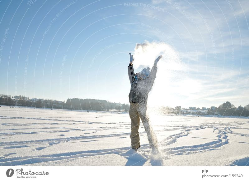 snow flurries Joy Playing Trip Freedom Sun Winter Snow Winter vacation Human being Arm Legs 1 Sky Beautiful weather Freeze Stand Romp Throw Bright Cold Blue
