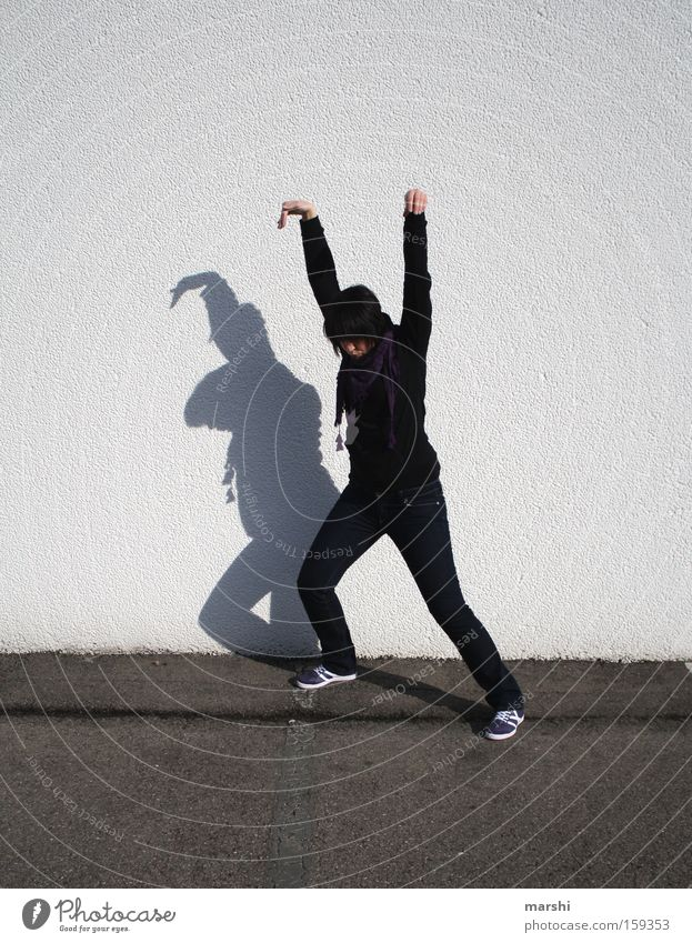 Kung Fu for beginners Martial arts Fight Attack Street Street art Shadow Funny Joy Concentrate Playing Traffic infrastructure Facial expression Gymnastics