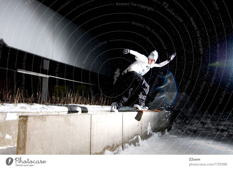 Snow Style Leisure and hobbies Action Posture Balance Snowboard Winter sports Freestyle Talented Night Night shot Snowboarding Slide Concrete wall Snowboarder