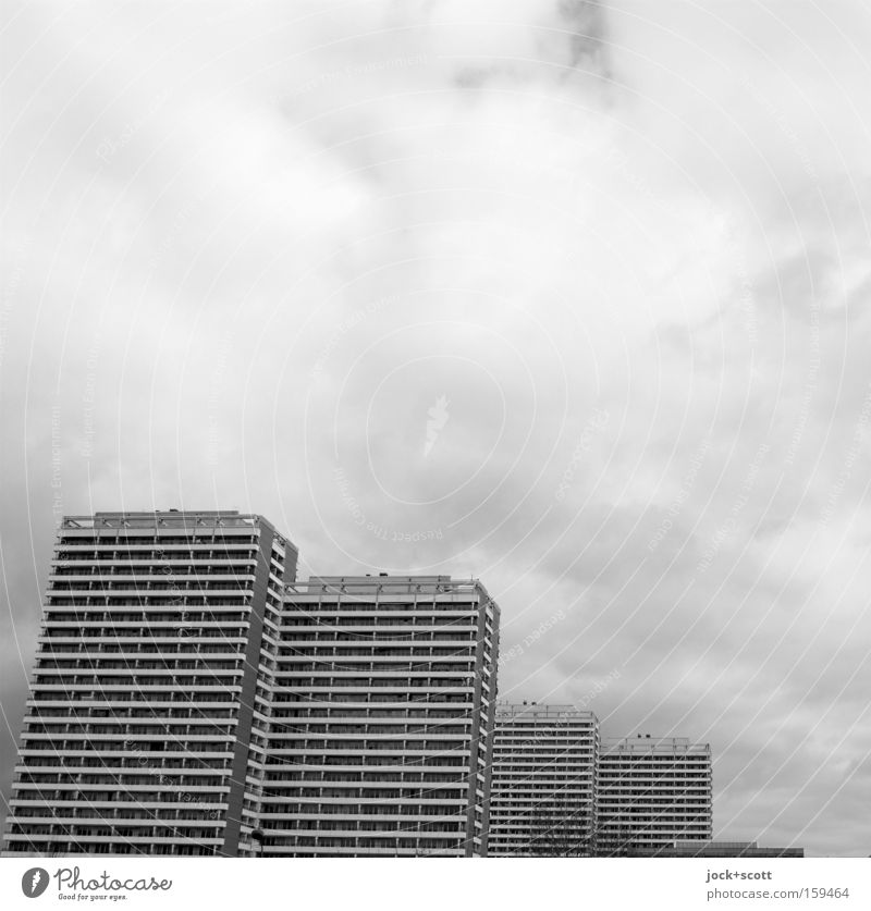 City Clouds House (Residential Structure) Cold Movement Gray Line Facade Living or residing High-rise Perspective Concrete Change Trust Row Sharp-edged