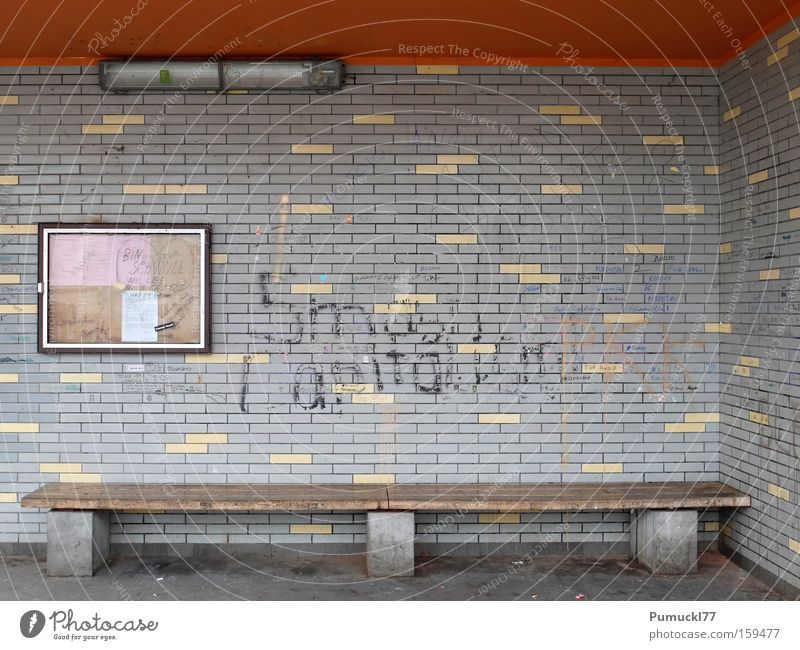 Loneliness Gray Sadness Graffiti Orange Dirty Architecture Empty Tile Display Bench Mural painting Bus stop Fluorescent Lights Wooden bench Shelter