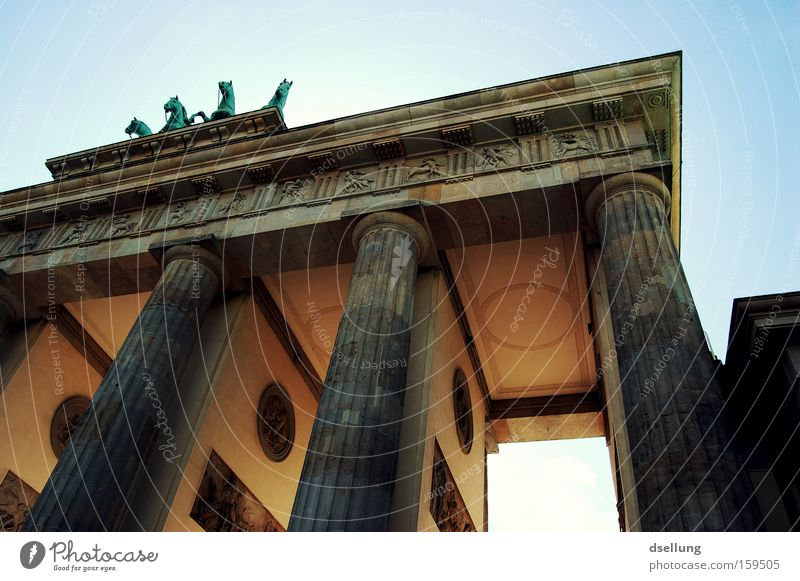 Partial view of Brandenburg Gate from bottom to top Berlin Capital city Summer Blooming Light Rider Carriage Horse Statue Monument Monumental Landmark Halo