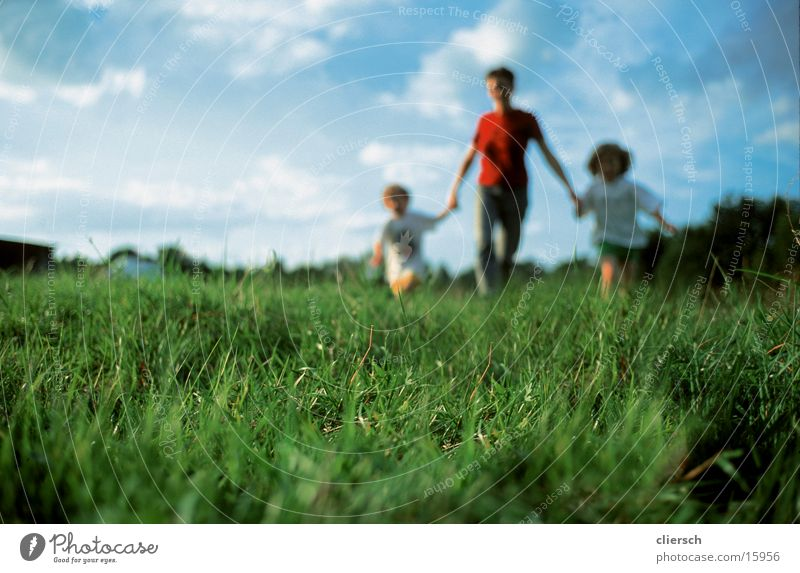 Human being Child Nature Summer Adults Parents Love Meadow Grass Feminine Family & Relations Group Together Infancy Group of children Mother