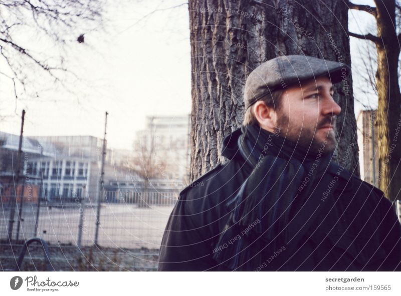 When's the bus coming? Man Human being Winter Cold Jacket Hat Facial hair Stand Lomography Analog Scarf Wait Face of a man Portrait photograph Looking away