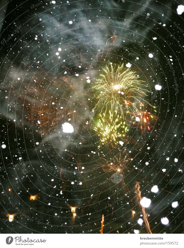 fire and ice Firecracker Snowflake New Year's Eve Black Spark Stars Winter Rocket flare Tracer path Night Party Yellow Red Universe Colour Sky Starry sky