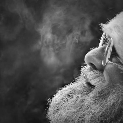Santa Claus Christmas & Advent Male senior Face Facial hair Fur hat Eyeglasses White-haired Beard smile Laughter Friendliness Black & white photo portrait