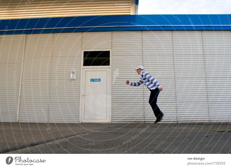 Human being Man Youth (Young adults) Blue White Adults Cold Wall (building) Wall (barrier) Building Door Facade Walking Masculine Running sports 18 - 30 years
