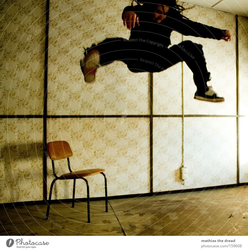 HANG TIME Man Jump Action Joy Dangerous Flying Fighter Room Window Sunlight Chair Wallpaper Line Whimsical Derelict Threat Aviation