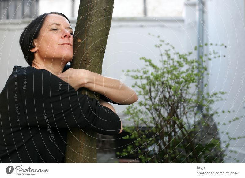 without words - with feeling Lifestyle Joy Leisure and hobbies Woman Adults Face 1 Human being 30 - 45 years 45 - 60 years Nature Spring Summer Tree Tree trunk