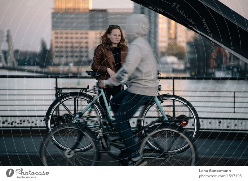 Two cyclists - Still and on the move Athletic Calm Vacation & Travel Tourism Sightseeing City trip Cycling Bicycle Closing time Human being Feminine Androgynous