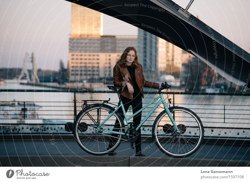 CYCLING WOMAN Vacation & Travel Tourism Sightseeing City trip Bicycle Closing time Human being Feminine Young woman Youth (Young adults) Woman Adults 1